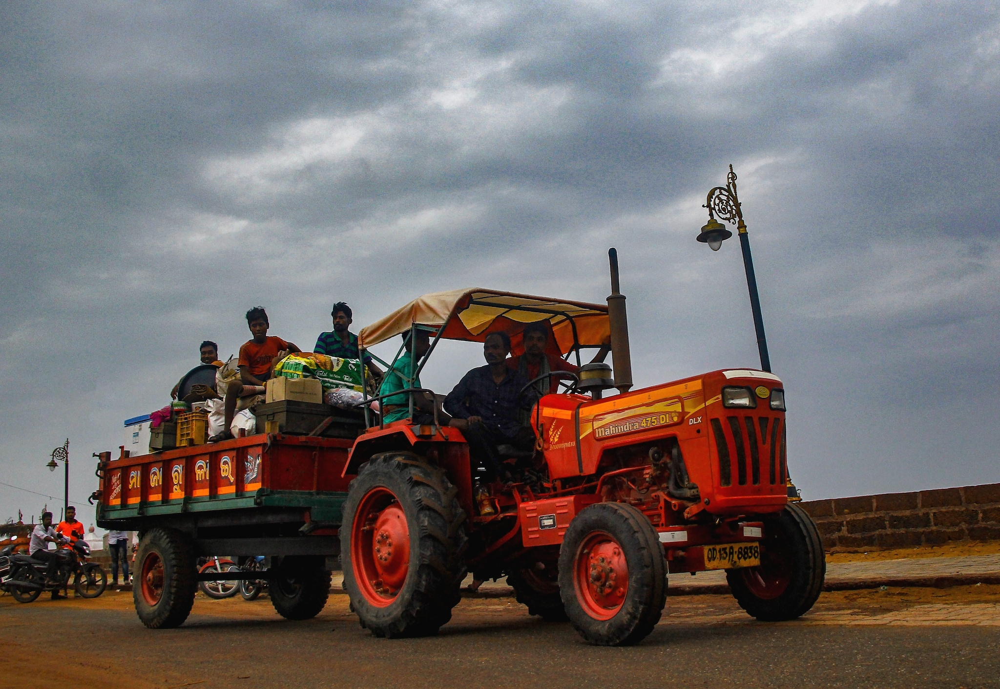 Villagers on their way to a shelter house on a tractor following evacuations as part of emergency measures taken before Cyclone Fani makes landfall, in Puri, Thursday, May 2, 2019. (PTI Photo)
