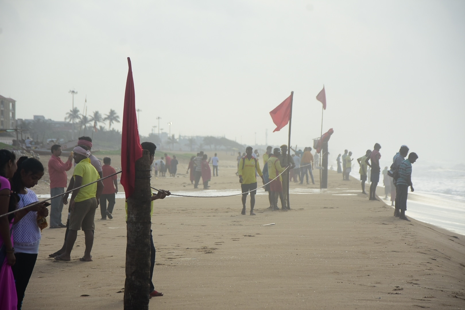 Red flags and ropes are being placed at the banks of the Puri beach as precautionary measures to keep tourists away from the beach in the wake of severe cyclonic storm 'Fani' in Odisha's Puri on May 2, 2019. (Photo: IANS)