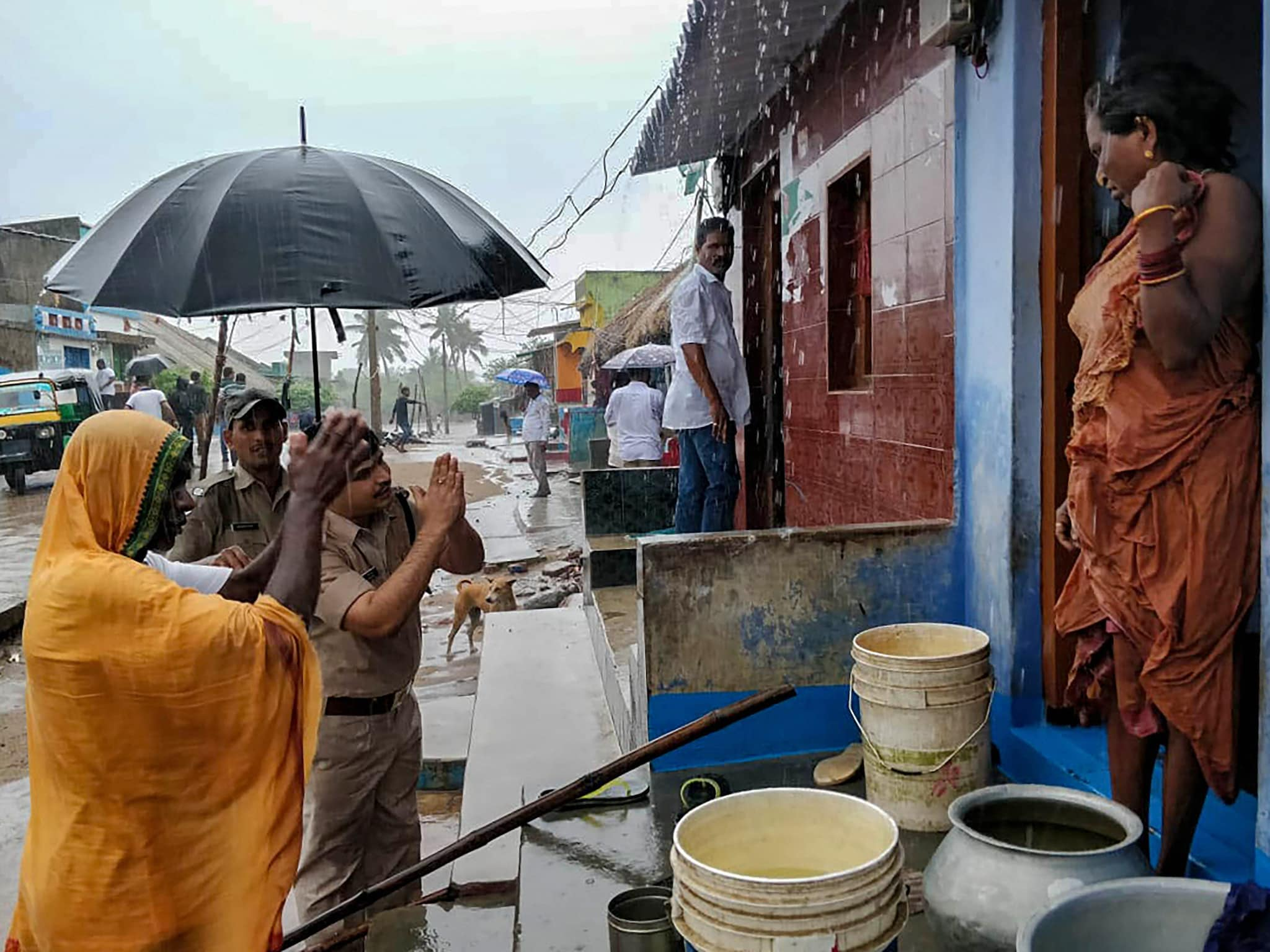 Superintendent of Police Pinak Mishra appeals to villagers living in vulnerable low-lying areas to shift to cyclone shelter house, in Brahmapur, Thursday, May 2, 2019. (PTI Photo)