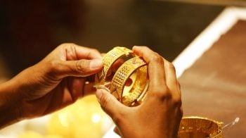 Gold prices fall on muted demand from jewellers; silver firms up