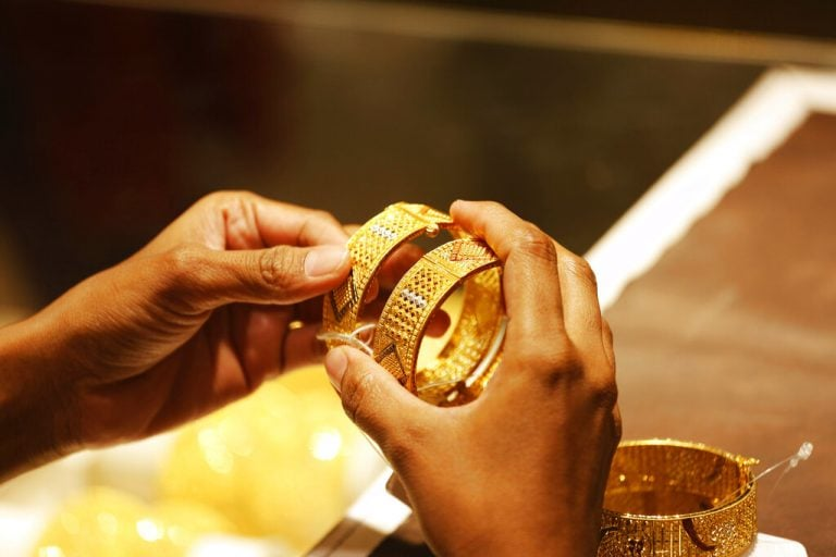 Gold prices fall further on strong rupee, silver also edges lower