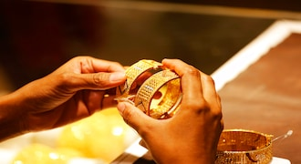 An Indian girl shops for gold bangles at a jewelry