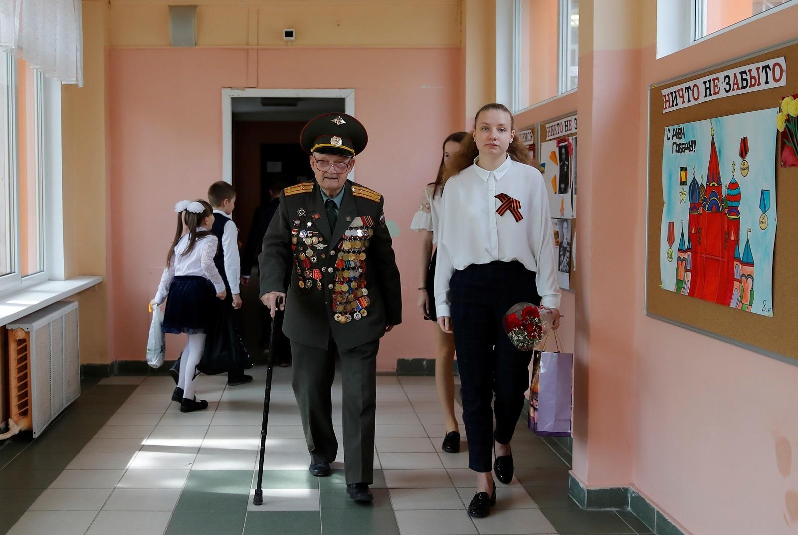 Veteran Nikolay Bagayev, 100, walks in a school in Korolyov, north of Moscow, Russia May 8, 2019. REUTERS/Maxim Shemetov