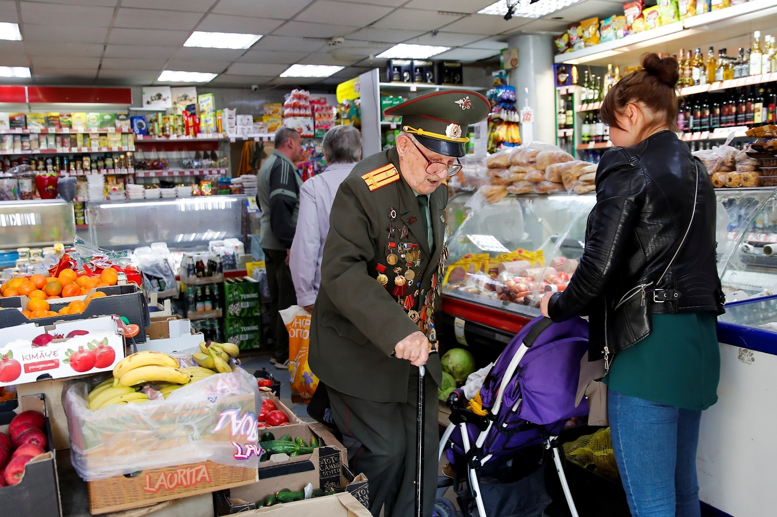 Veteran Nikolay Bagayev, 100, leaves a food store after May Day celebrations, in Korolyov, north of Moscow, Russia May 1, 2019. REUTERS/Maxim Shemetov