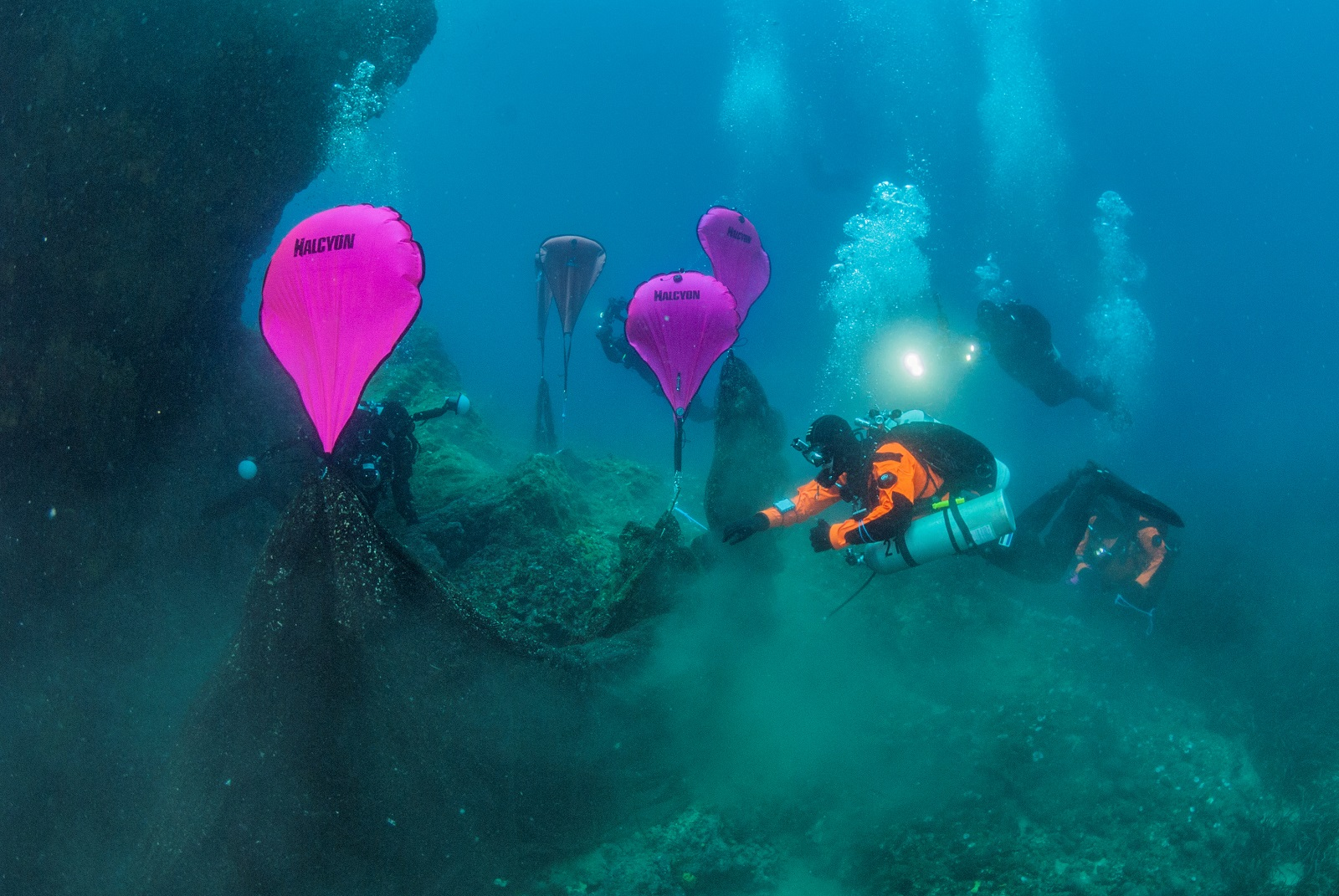 Divers inflate lifting bags attached to a ghost fishing net on the seabed at the village of Stratoni, near Halkidiki, Greece, May 18, 2019. Areti Kominou/Ghost Fishing Greece/Handout via REUTERS