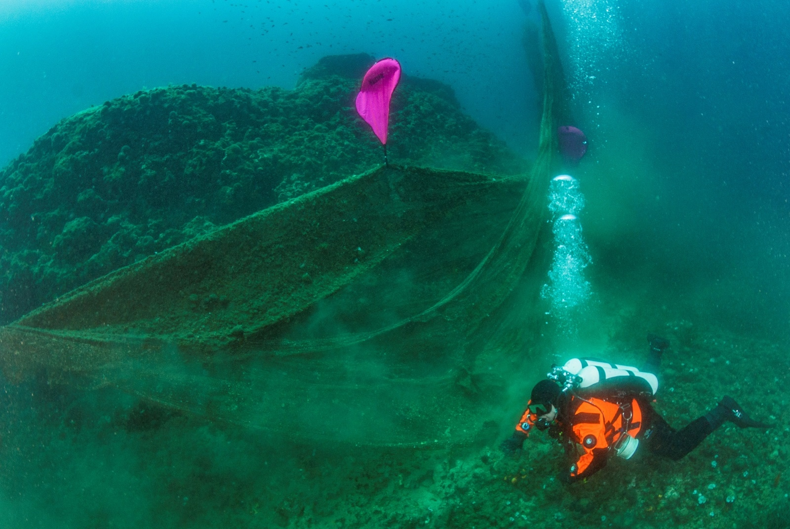 A diver swims next to a ghost fishing net on the seabed at the village of Stratoni, near Halkidiki, Greece, May 18, 2019. Areti Kominou/Ghost Fishing Greece/Handout via REUTERS