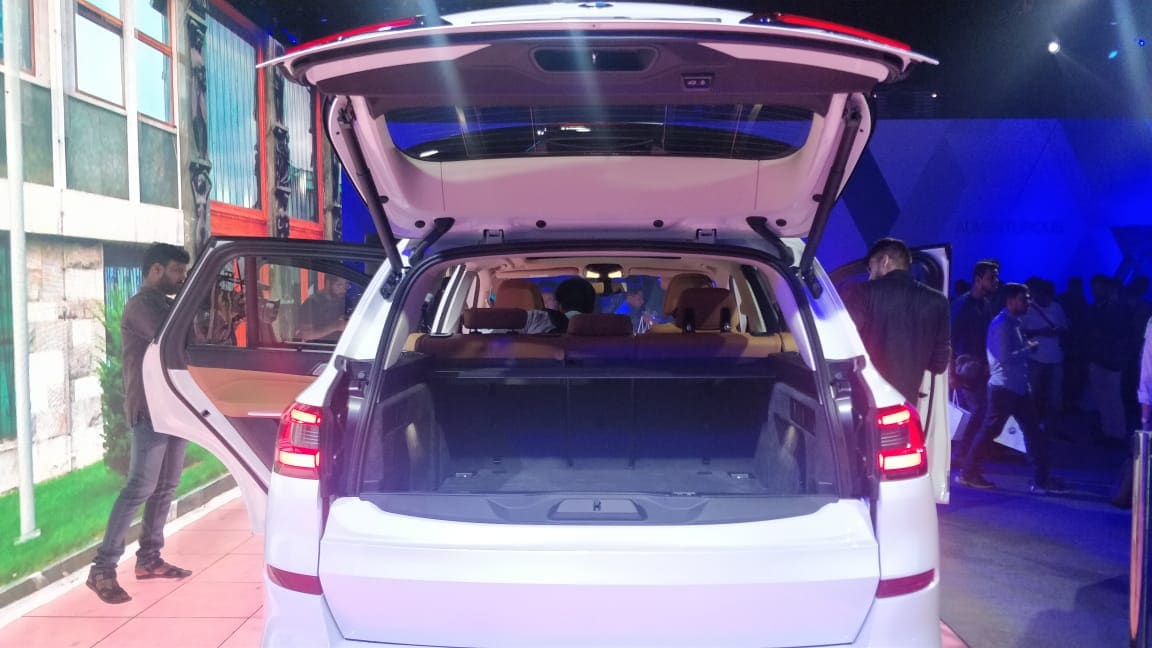 The 'Luggage-Compartment Package' feature in the car includes slide rails for easy loading and an electrical luggage compartment roller blind.
