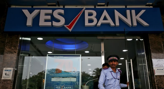 A watchman steps out of a Yes Bank branch in Mumbai