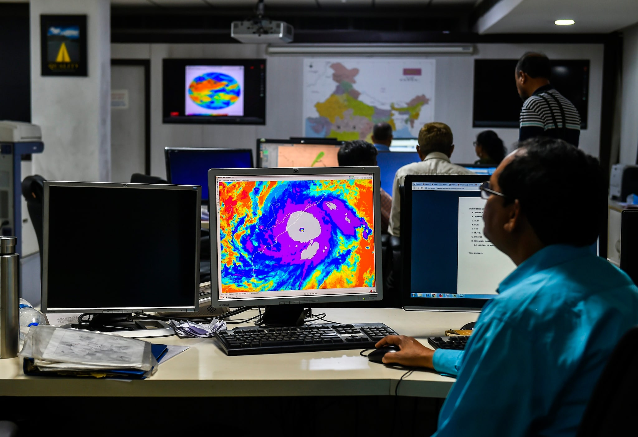 Officials monitor the progress of Cyclone 'Fani', at Mausam Bhavan in New Delhi, Thursday, May 02, 2019. (PTI Photo/Kamal Singh)