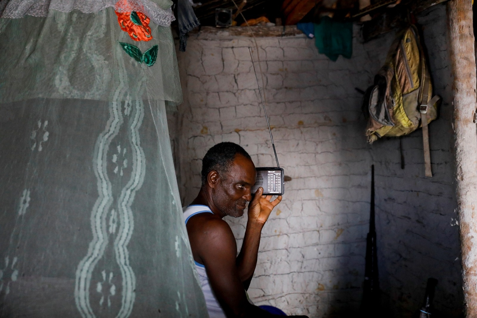 Fisherman Jose da Cruz listens to the radio inside his house, in Cairu, state of Bahia, Brazil, April 5, 2019. REUTERS/Nacho Doce