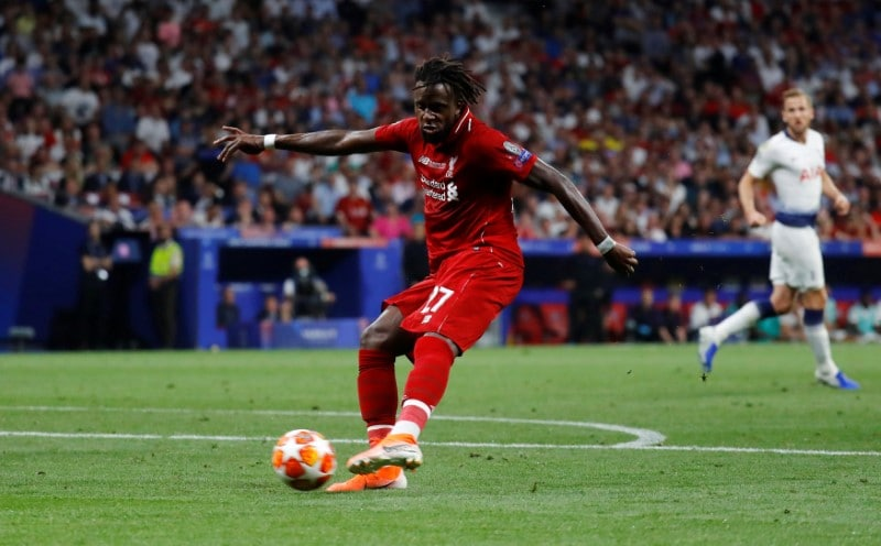 Liverpool substitute Divock Origi scores a late goal to put the Reds 2-0 ahead and the game beyond Tottenham Hotspur's reach. (Reuters)