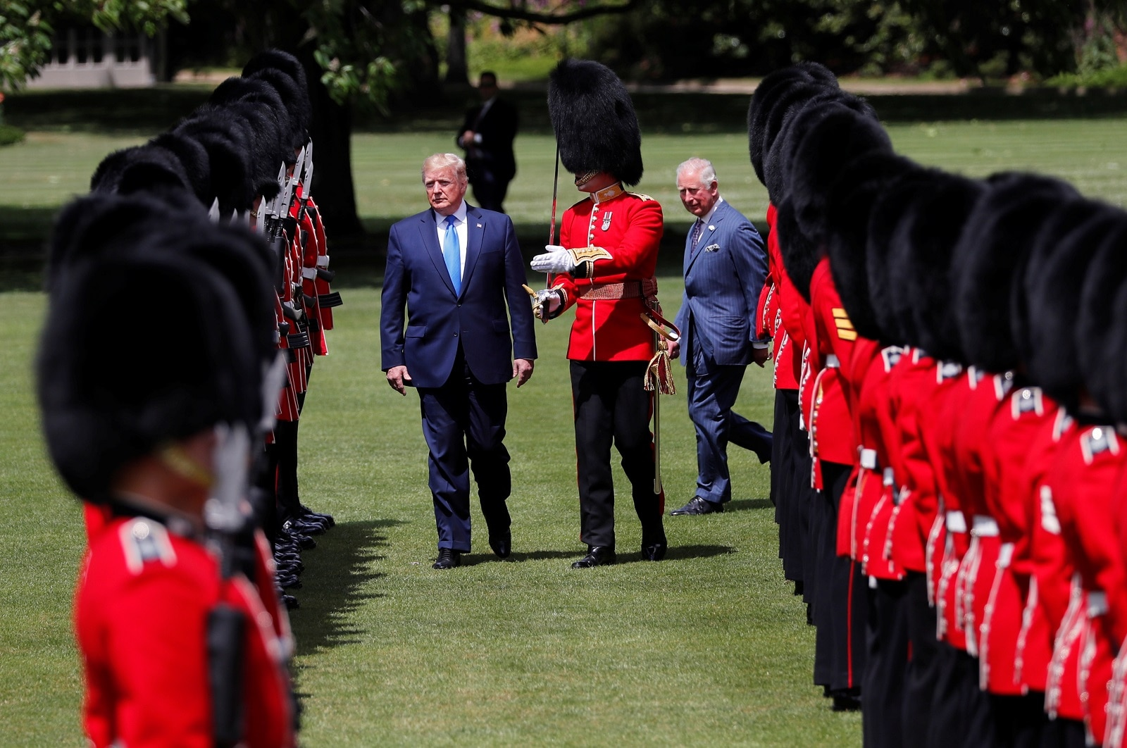 US President Donald Trump inspects an honour guard during a welcome ceremony in Buckingham Palace, in London, Britain, June 3, 2019. REUTERS/Carlos Barria