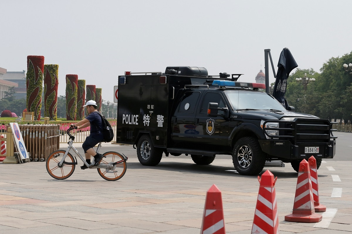 A police vehicle is deployed in Tiananmen Square. China has never released a final death toll from the events on and around June 4. Estimates from human rights groups and witnesses range from several hundred to thousands. REUTERS/Thomas Peter