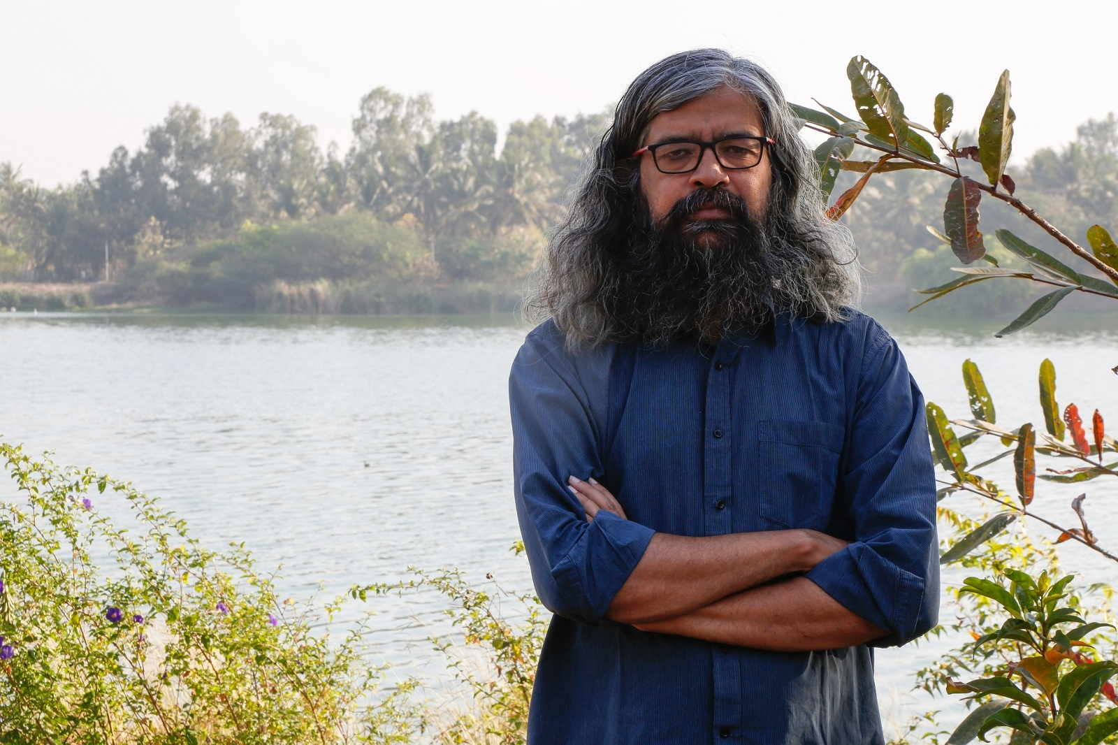 Vishwanath Srikantaiah, a water conservation and urban planning expert, poses for a photo near Jakkur Lake in Bangalore, on March 15, 2019. Thomson Reuters Foundation/Annie Banerji