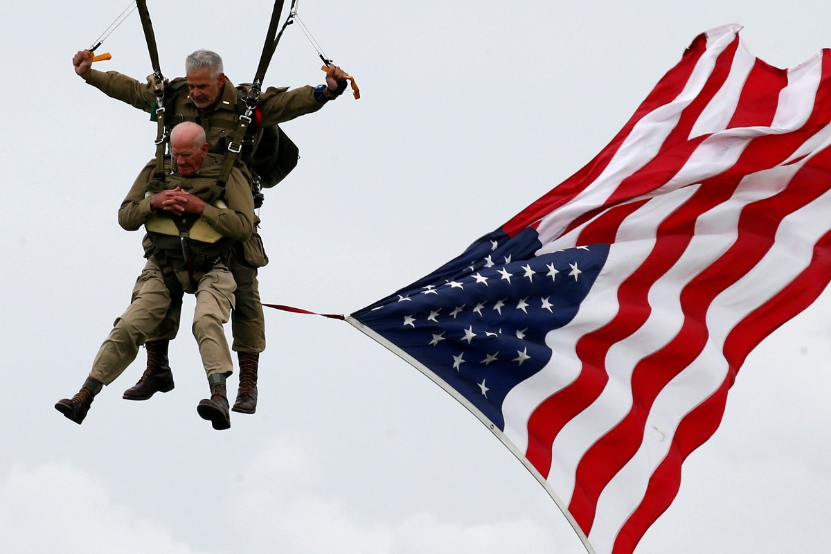US World War II paratrooper veteran Tom Rice, 97 years-old who served with the 101st Airborne, jumps during a commemorative parachute jump over Carentan on the Normandy coast ahead of the 75th D-Day anniversary. REUTERS/Pascal Rossignol
