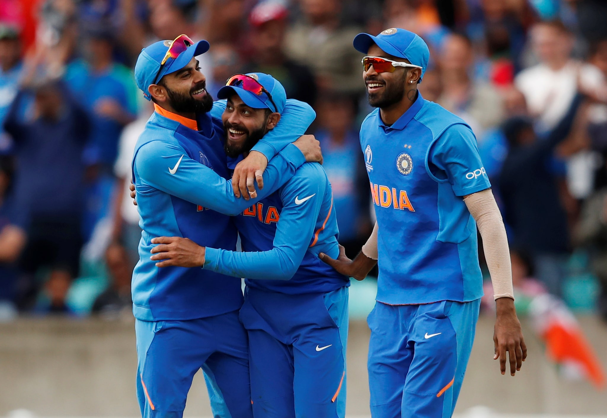 Cricket - ICC Cricket World Cup - India v Australia - The Oval, London, Britain - June 9, 2019 India's Ravindra Jadeja celebrates taking a catch off Australia's Glenn Maxwell with team mates Action Images via Reuters/Andrew Boyers