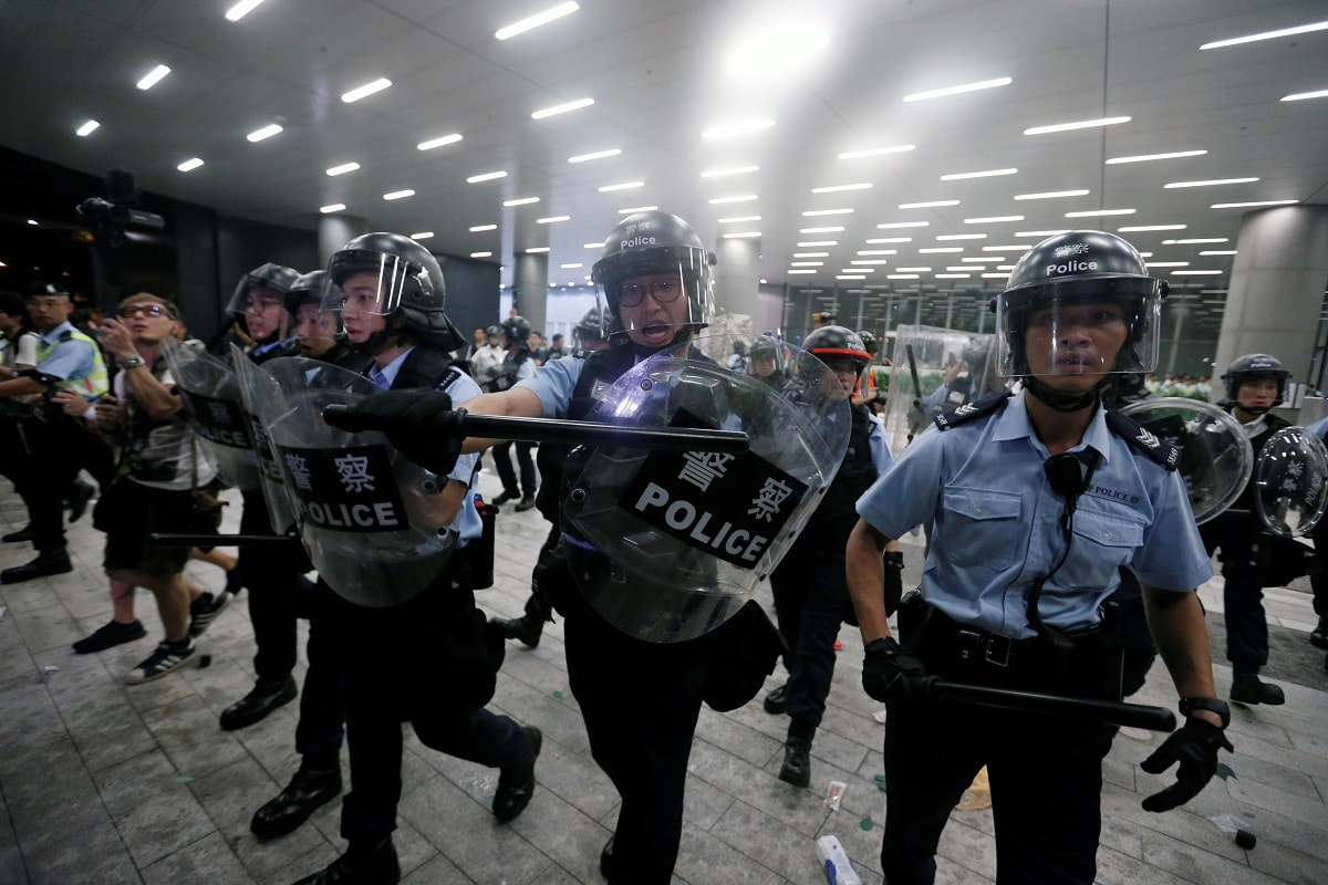 Protesters charged police lines to try to force their way into the Legislative Council building, and police charged back, using pepper spray, after warning the protesters. REUTERS/Thomas Peter