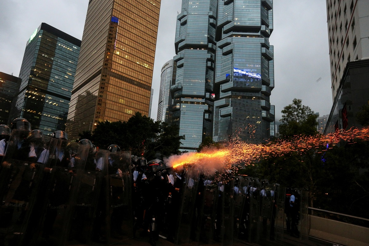 Police officers fire tear gas during a demonstration against a proposed extradition bill in Hong Kong. REUTERS/Athit Perawongmetha