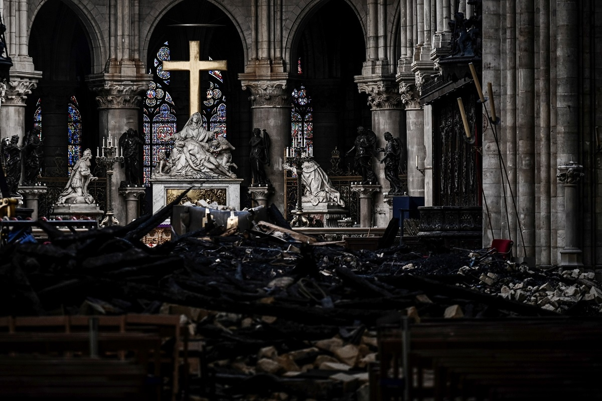 A picture shows rubbles and the cross at the altar, inside the Notre-Dame Cathedral after it sustained major fire damage from the previous month, during the visit of Canadian Prime Minister in Notre-Dame Cathedral in Paris, France May 15, 2019. Philippe Lopez/Pool via REUTERS/File Photo