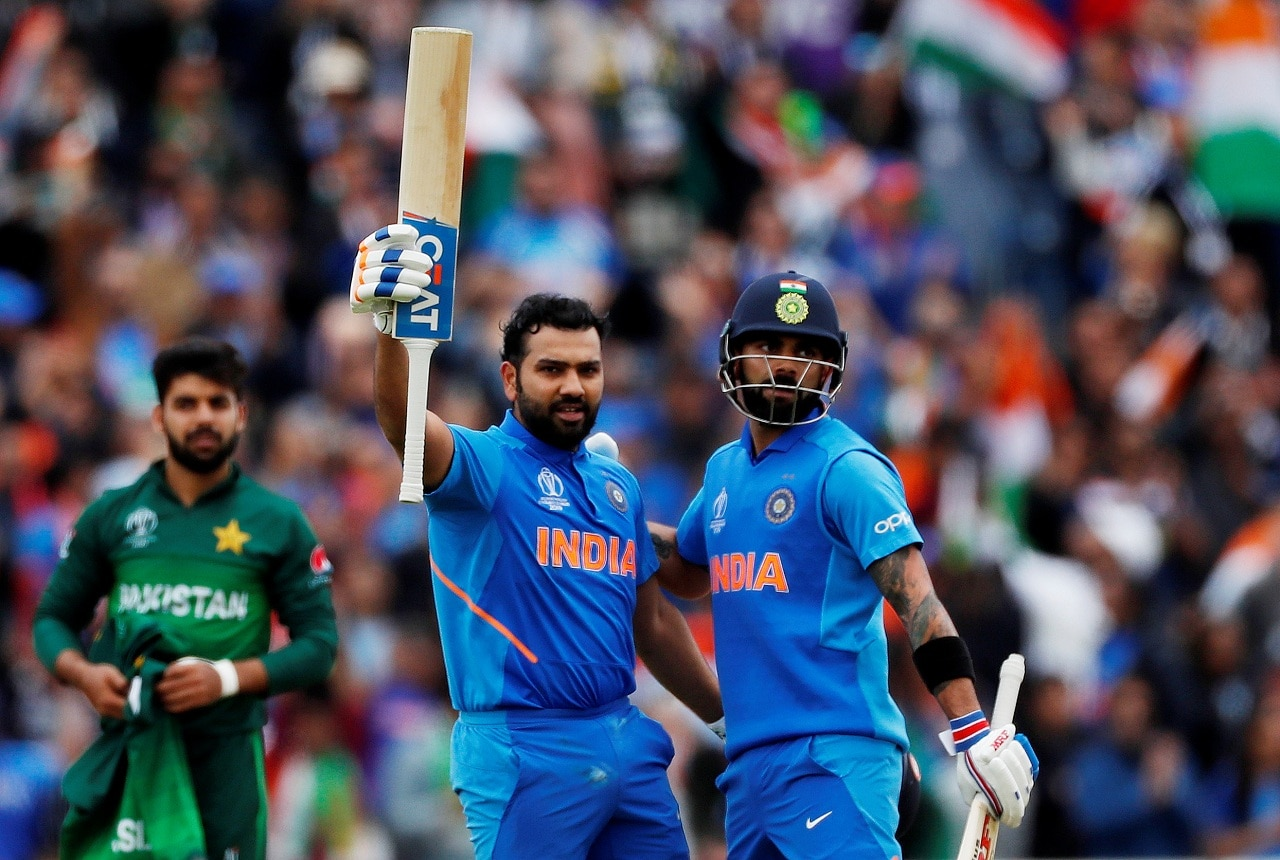 Cricket - ICC Cricket World Cup - India vs Pakistan - Emirates Old Trafford, Manchester, Britain - June 16, 2019 India's Rohit Sharma celebrates his century with Virat Kohli Action Images via Reuters/Lee Smith