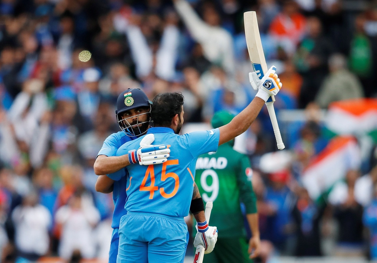 Cricket - ICC Cricket World Cup - India vs Pakistan - Emirates Old Trafford, Manchester, Britain - June 16, 2019 India's Rohit Sharma celebrates his century with Virat Kohli Action Images via Reuters/Andrew Boyers