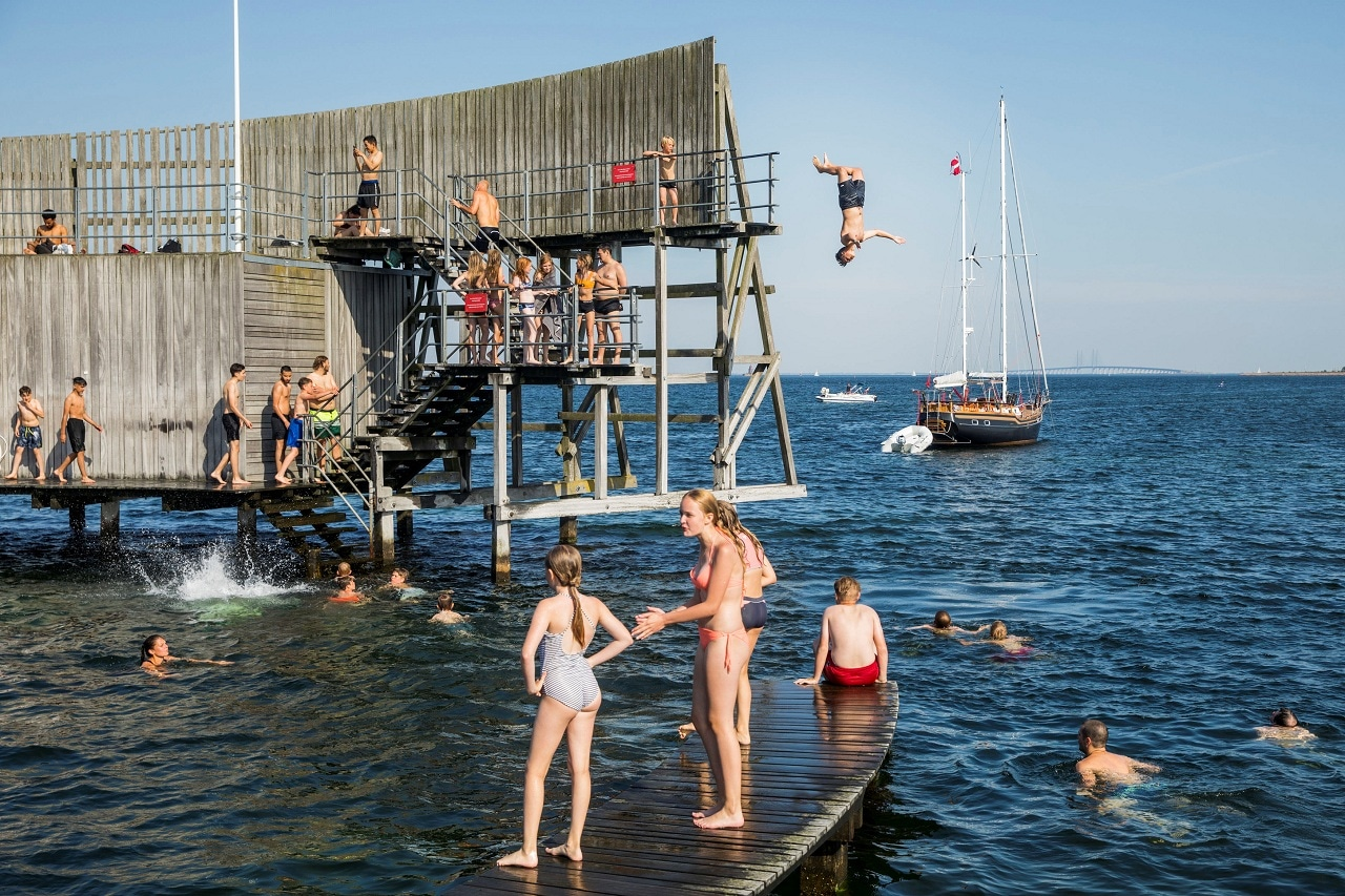 Boys jump in the water at the Snail on Amager in Copenhagen, Denmark June 25, 2019. Nikolai Linares/Ritzau Scanpix/via REUTERS