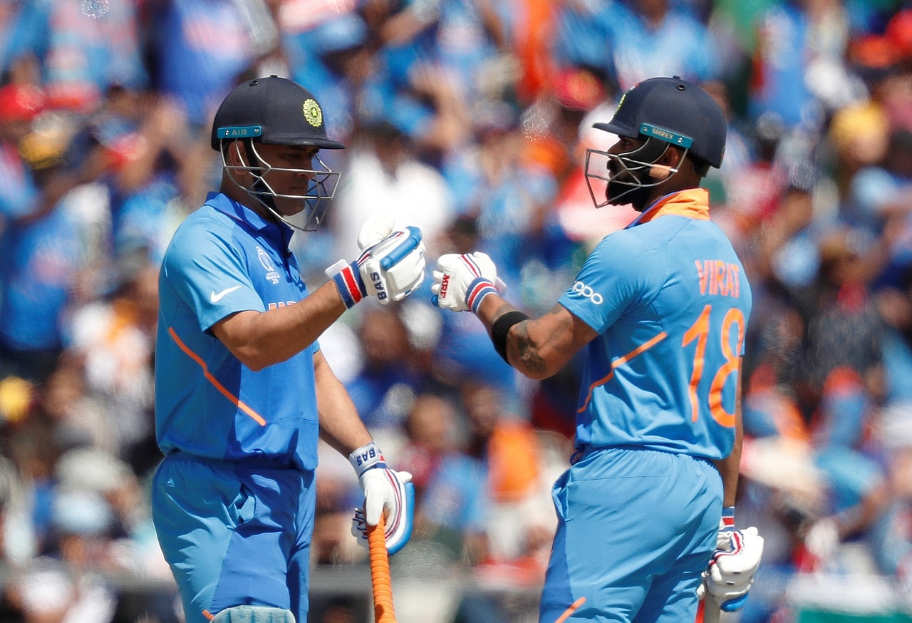 Cricket - ICC Cricket World Cup - West Indies v India - Old Trafford, Manchester, Britain - June 27, 2019 India's MS Dhoni and Virat Kohli celebrate Action Images via Reuters/Lee Smith