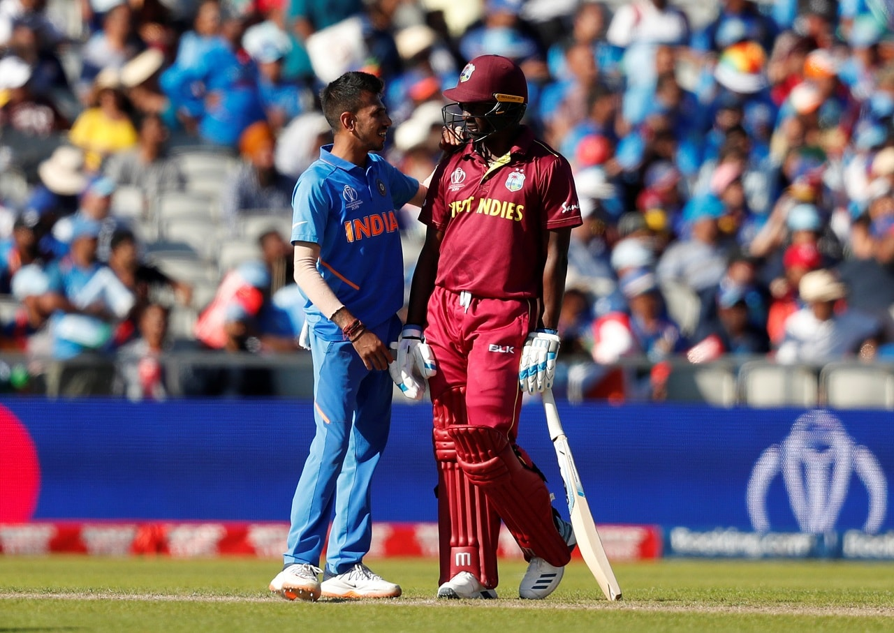 Cricket - ICC Cricket World Cup - West Indies v India - Old Trafford, Manchester, Britain - June 27, 2019 India's Yuzvendra Chahal talks with West Indies' Kemar Roach during the match Action Images via Reuters/Lee Smith
