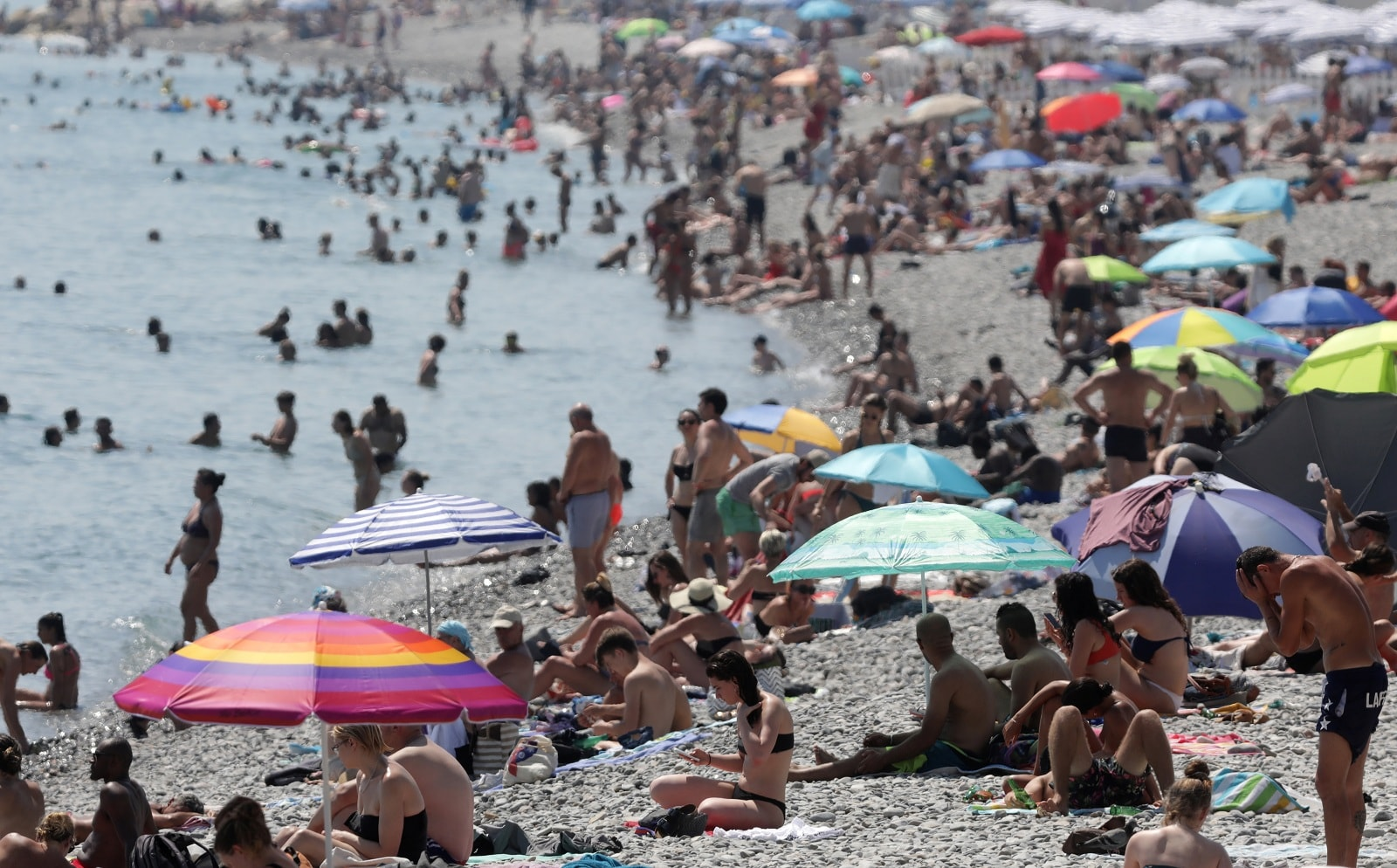 People cool off in the sea in Nice as a heatwave hits much of the country, France, June 27, 2019. REUTERS/Eric Gaillard