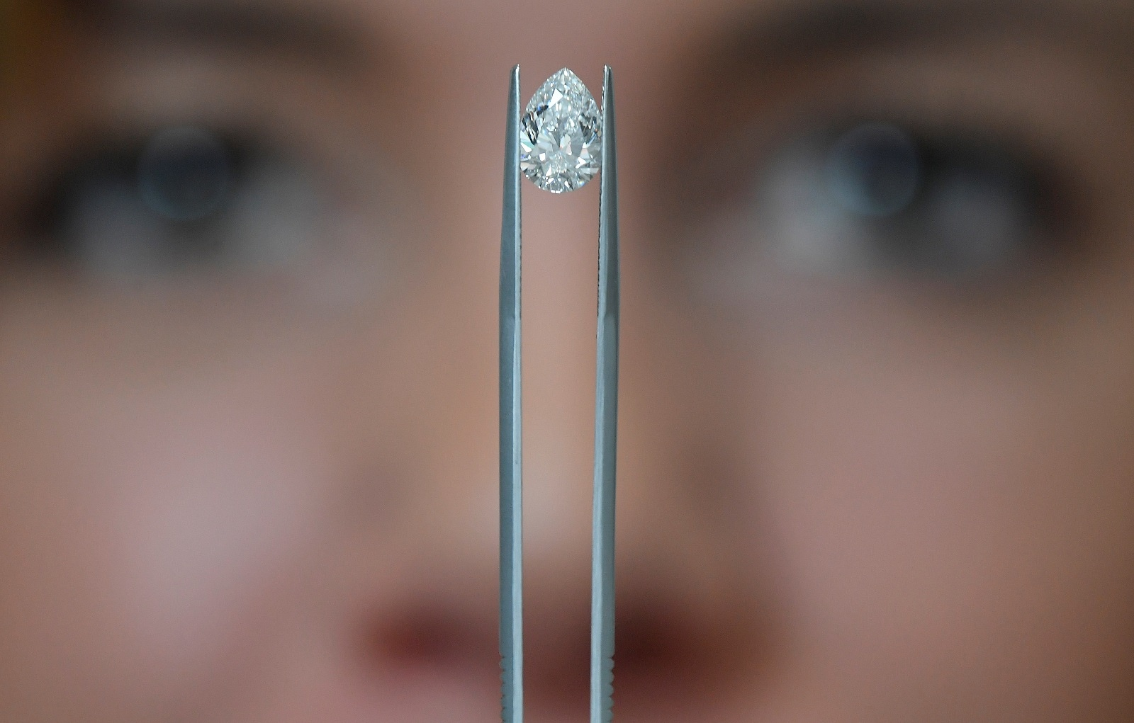 Sophie Lomax shows a pear shape diamond, June 26, 2019. REUTERS/Toby Melville