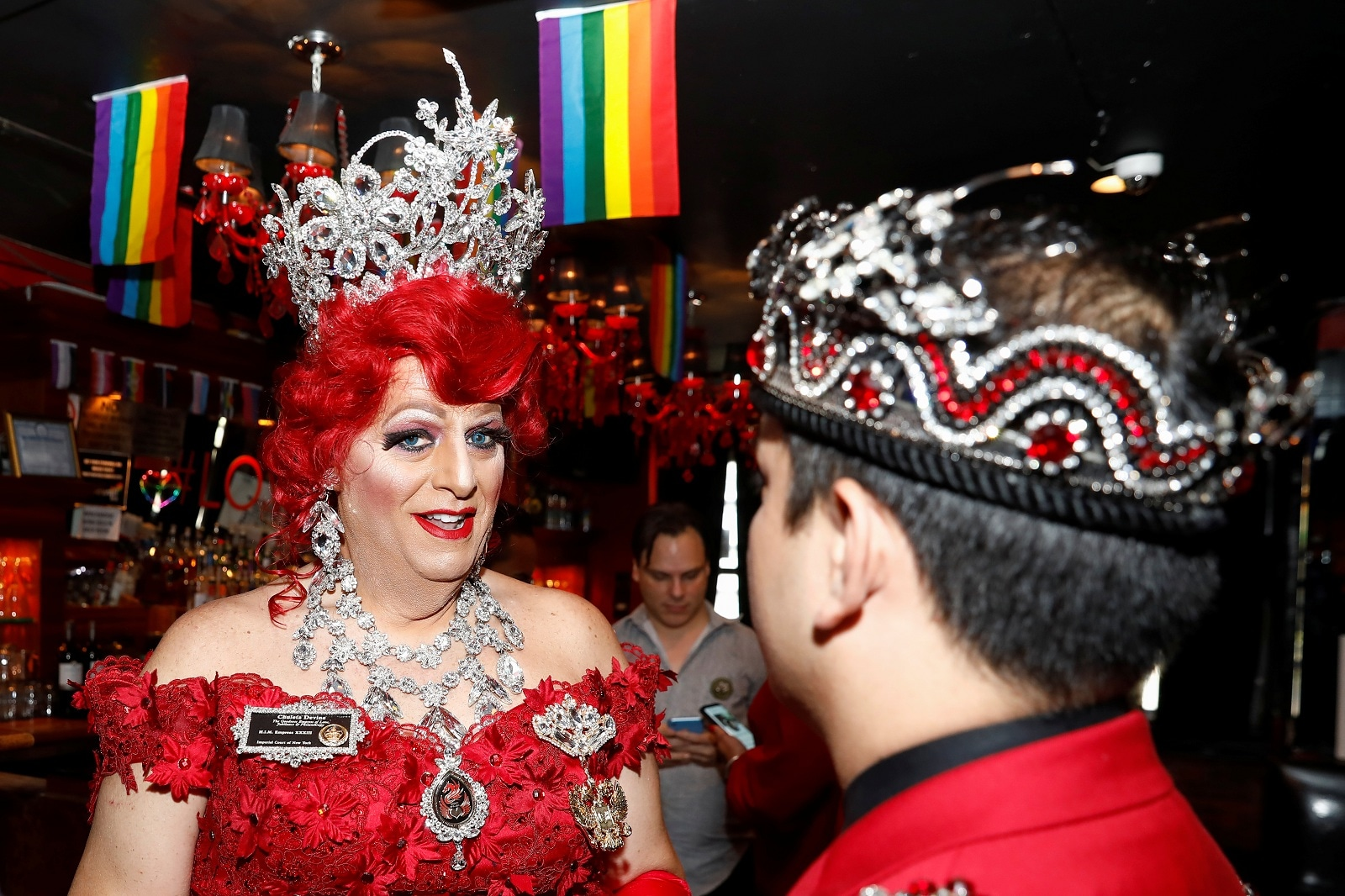 Chuleta Divine, a member of the Imperial Court of New York, a social, fundraising organization which has raised millions of dollars for social service and health support organizations, smiles inside the Stonewall Inn in New York, US, June 27, 2019. REUTERS/Shannon Stapleton