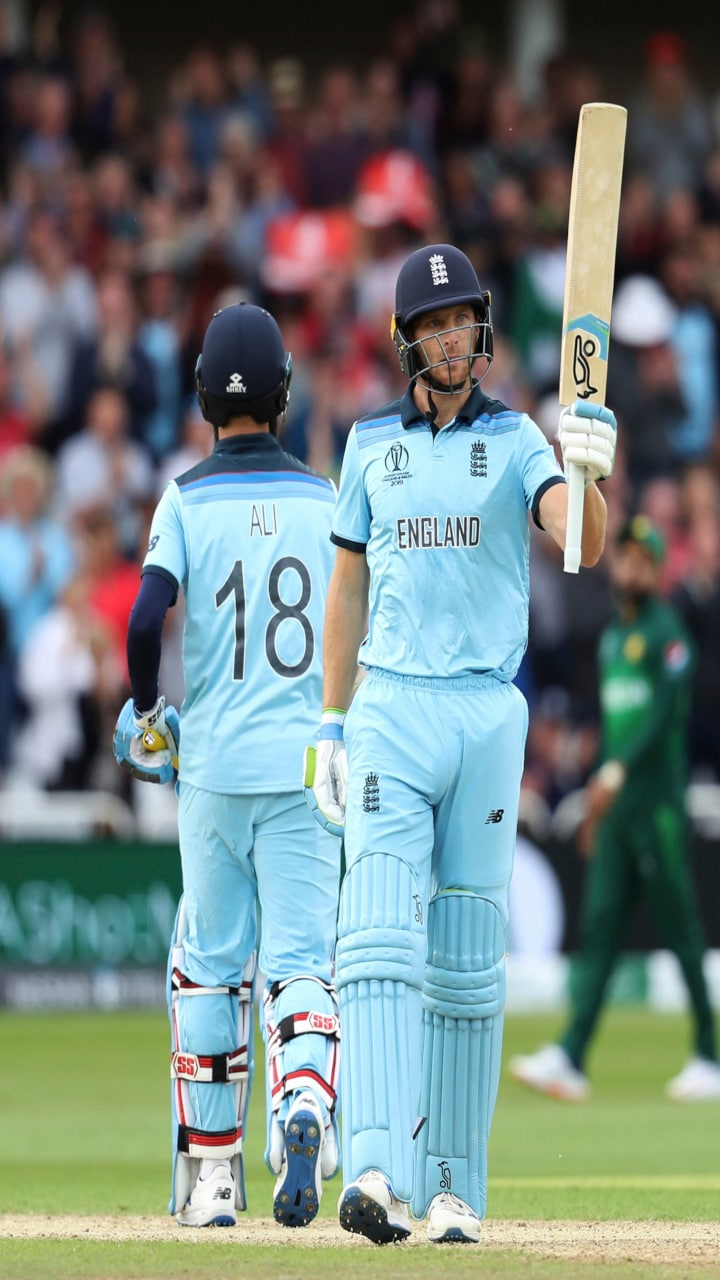 England's Jos Buttler, right, raises his bat to celebrate scoring a century during the Cricket World Cup match between England and Pakistan at Trent Bridge in Nottingham, Monday, June 3, 2019. (AP/PTI)