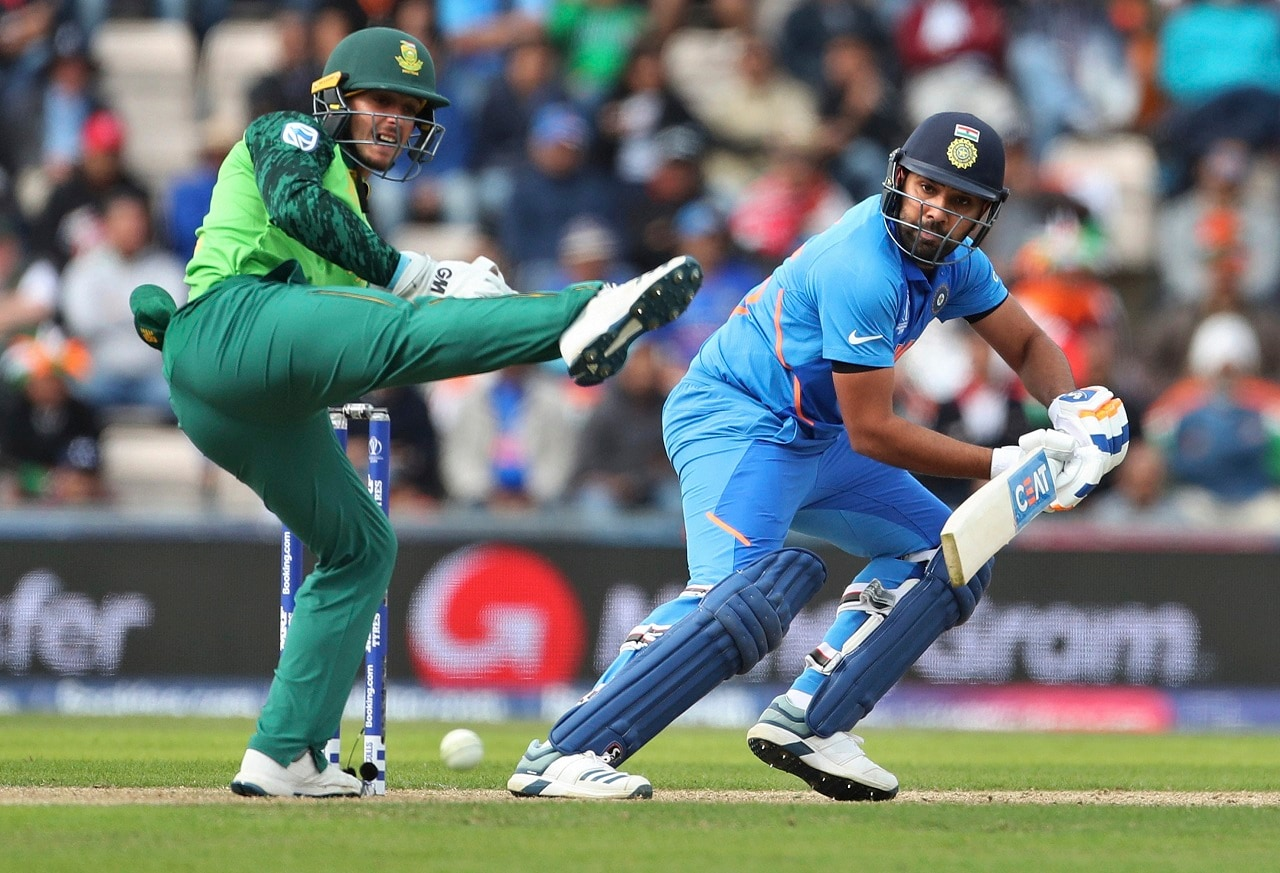 South Africa's wicketkeeper Quinton de Kock, left, reacts as India's Rohit Sharma, right, plays a shot during the Cricket World Cup match between South Africa and India at the Hampshire Bowl in Southampton, England, Wednesday, June 5, 2019. AP/PTI(AP6_5_2019_000244B)