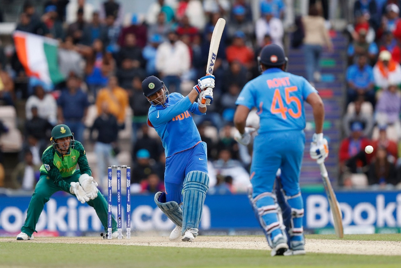 India's MS Dhoni hits 2 runs off the bowling of South Africa's Tabraiz Shamsi during their Cricket World Cup match between South Africa and India at the Hampshire Bowl in Southampton, England, Wednesday, June 5, 2019. AP/PTI(AP6_5_2019_000249B)