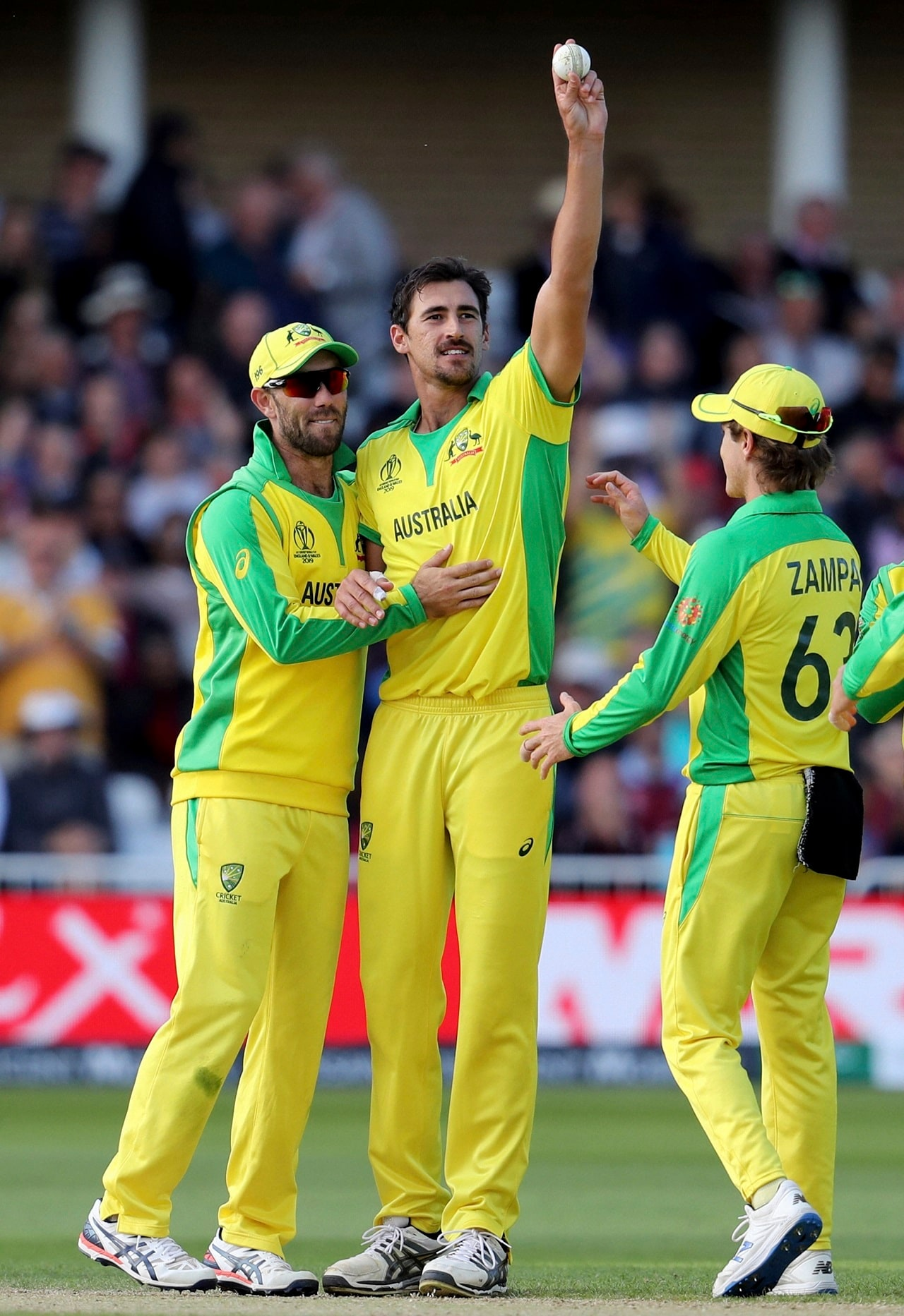 Australia's Mitchell Starc, center, holds up the ball to celebrate the dismissal of West Indies' Sheldon Cottrell during the Cricket World Cup match between Australia and West Indies at Trent Bridge in Nottingham, Thursday, June 6, 2019. AP/PTI(AP6_6_2019_000161B)