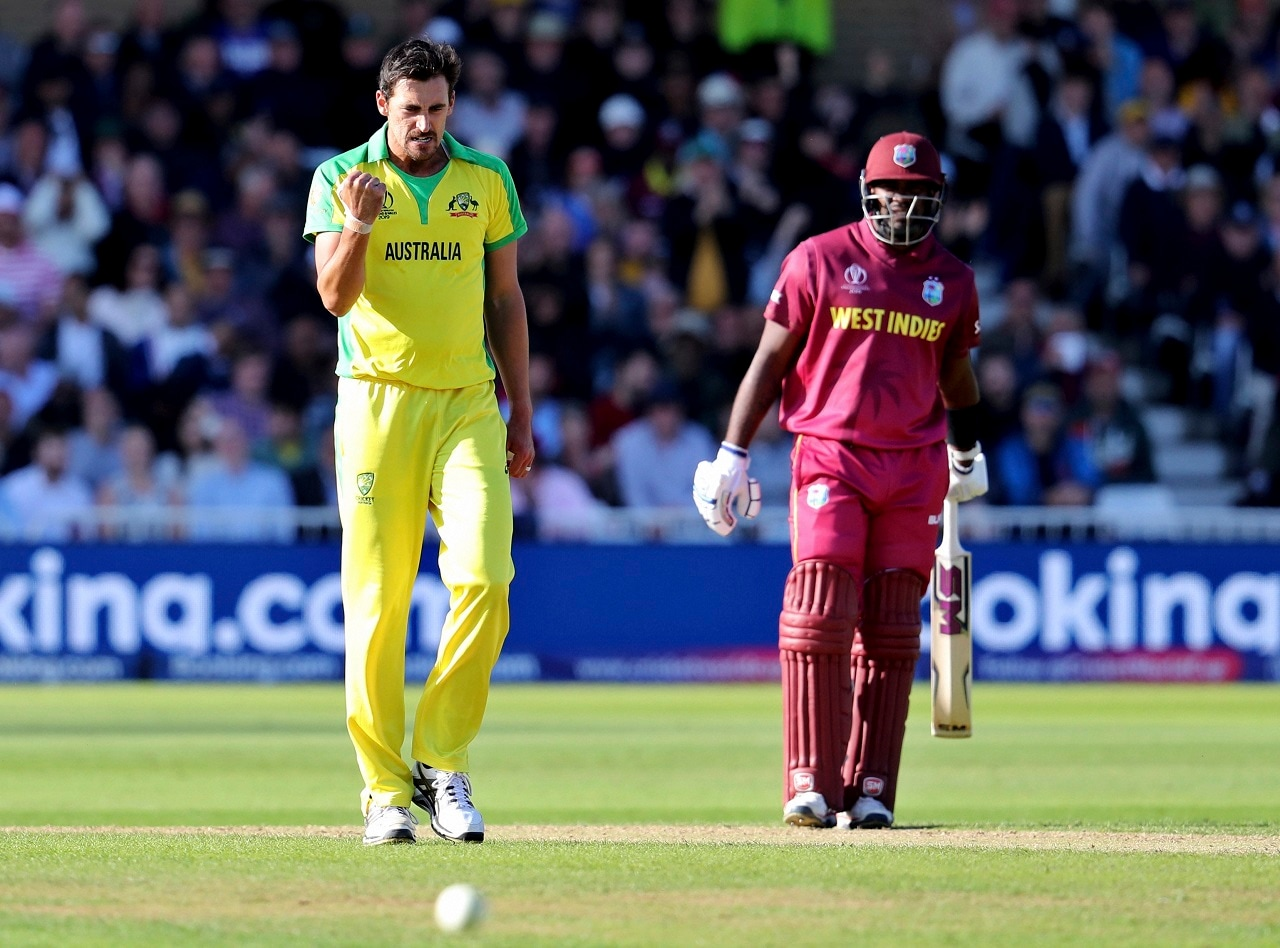 Australia's Mitchell Starc, left, celebrates the dismissal of West Indies' captain Jason Holder during the Cricket World Cup match between Australia and West Indies at Trent Bridge in Nottingham, Thursday, June 6, 2019.AP/PTI(AP6_6_2019_000162B)