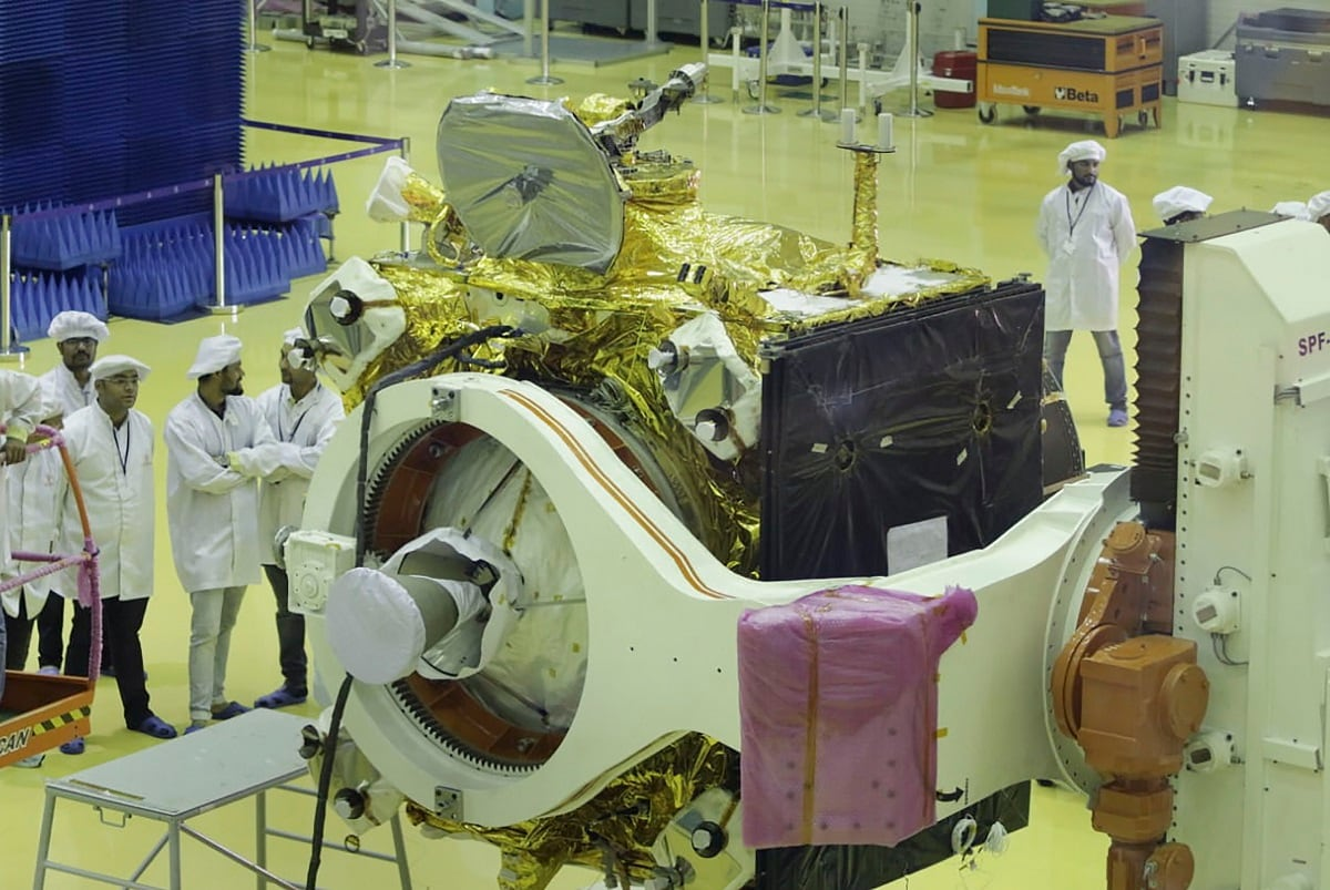 Indian Space Research Organisation (ISRO) personnel gives final touches to Chandrayaan2, India's second lunar mission that is scheduled to be launched between July 9 and 16, at ISRO Satellite Integration and Testing Establishment facility in Bengaluru. (PTI Photo)