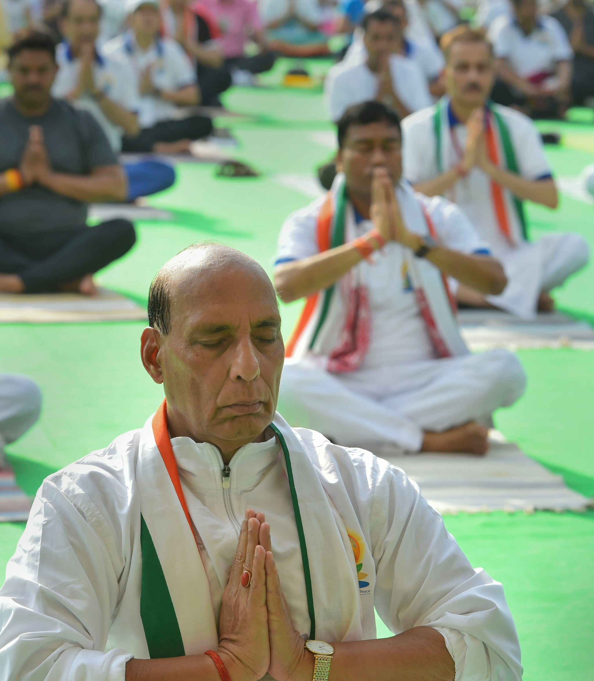 New Delhi: Defence Minister Rajnath Singh performs yoga during the 5th International Day of Yoga at Rajpath, in New Delhi, Friday, June 21, 2019. (PTI Photo/Arun Sharma)