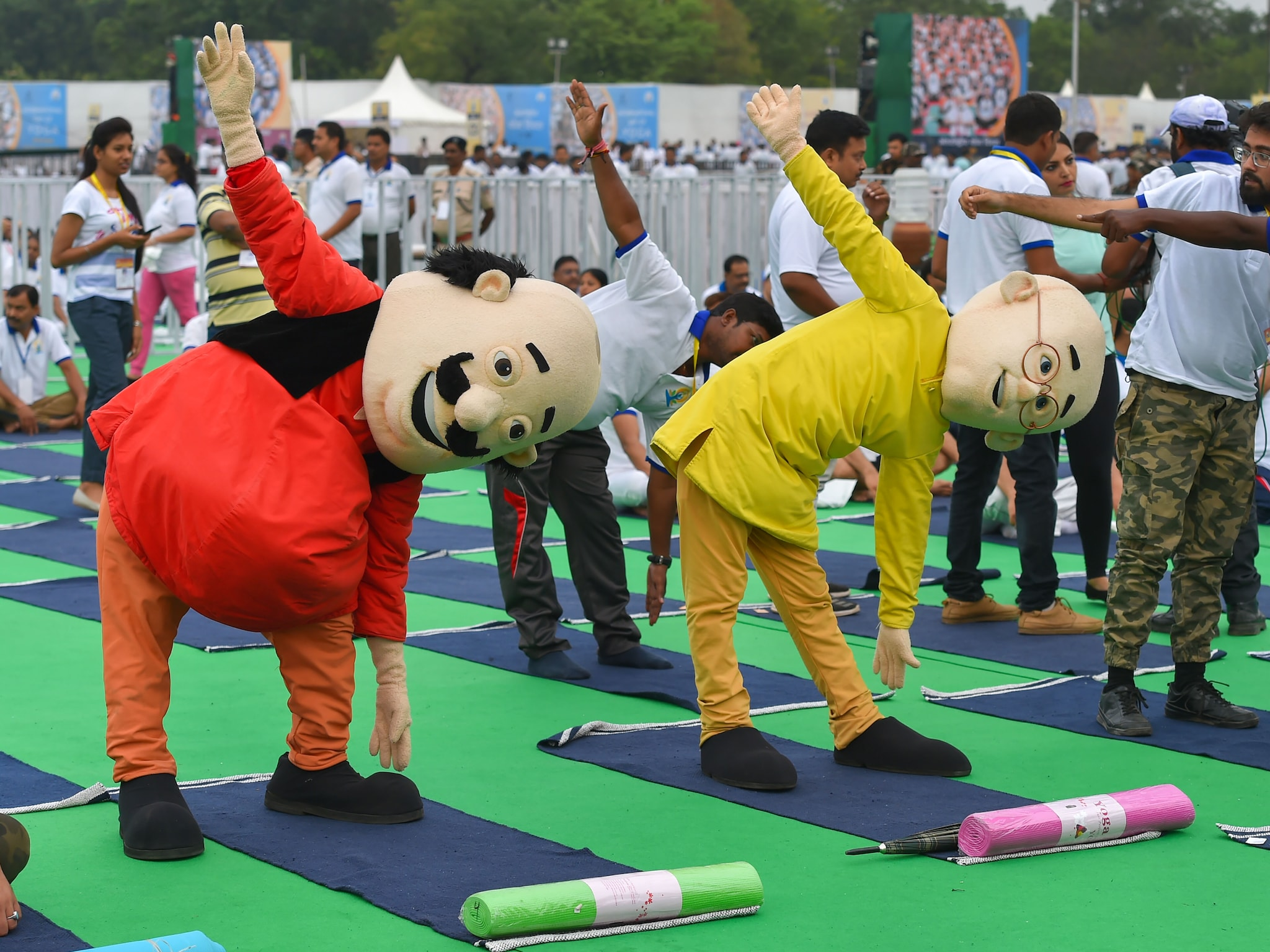 Ranchi: Indian animated characters Motu Patlu perform yoga during a mass yoga event on the 5th International Day of Yoga at Prabhat Tara ground, in Ranchi, Friday, June 21, 2019. (PTI Photo/Kamal Kishore)