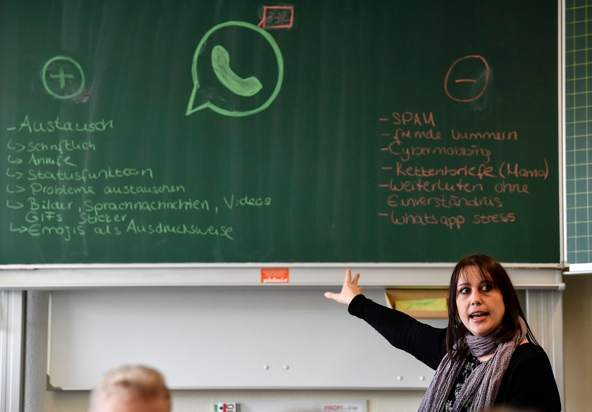 Teacher Vera Servaty talks to pupils during a lesson in social media and the internet.  (AP Photo/Martin Meissner)