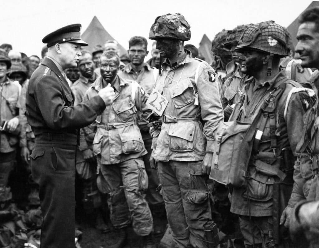 US Gen. Dwight D. Eisenhower, left, gives the order of the day to paratroopers in England prior to boarding their planes to participate in the first assault of the Normandy invasion. A dwindling number of D-Day veterans will be on hand in Normandy in June 2019, when international leaders gather to honor them on the invasion's 75th anniversary. June 6, 1944. (US Army Signal Corps via AP)