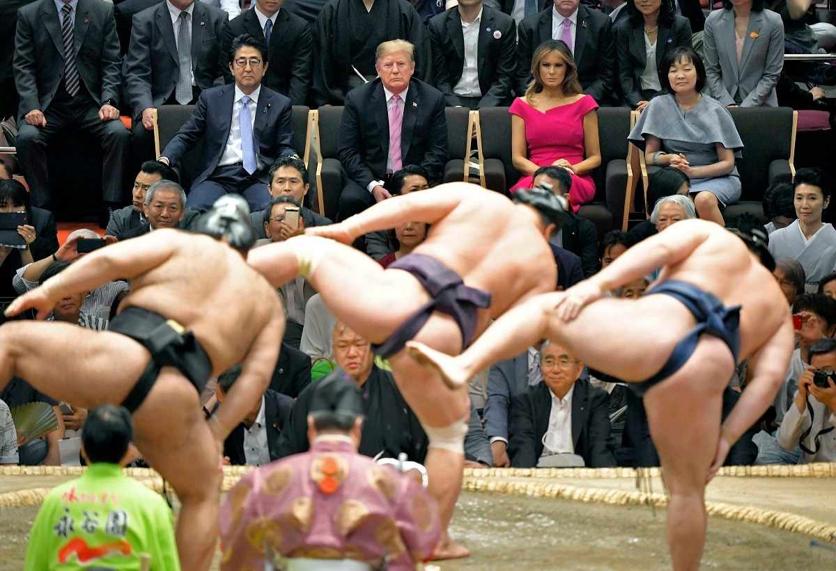 US President Donald Trump and First Lady Melania Trump accompanied by Japanese Prime Minister Shinzo Abe and his wife Akie Abe watch the ring-entering ceremony of sumo wrestlers during an annual summer sumo wrestling championship in Tokyo. (Kyodo News via AP, File)