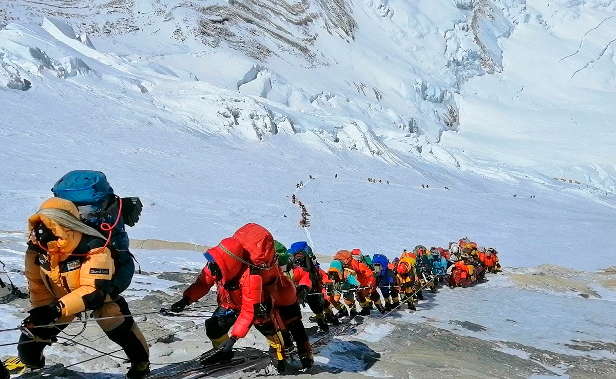 A long queue of mountain climbers lines a path on Mount Everest just below camp four, in Nepal. Seasoned mountaineers say the Nepal government's failure to limit the number of climbers on Mount Everest has resulted in dangerous overcrowding and a greater number of deaths. (AP Photo/Rizza Alee, File)