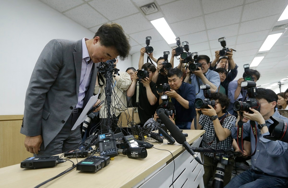 The Very Good Tour agency senior official Lee Sang-moo, left, bows to make an apology during a press conference at its headquarters in Seoul, South Korea. A sightseeing boat carrying 33 South Korean passengers and two crew members collided with another vessel and sank in the Danube River in downtown Budapest. (AP Photo/Ahn Young-joon, File)