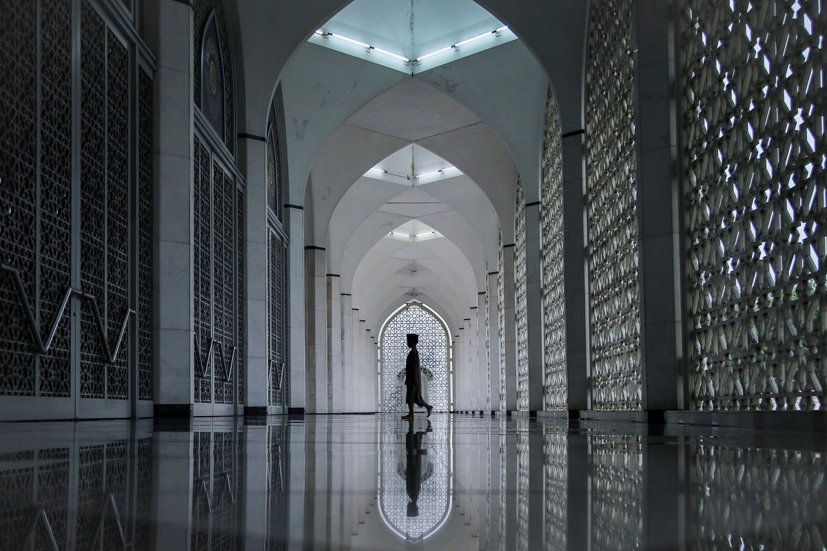 A Muslim boy arrives at a mosque during Ramadan, the holiest month in the Islamic calendar, on Thursday, Malaysia. (AP Photo/Annice Lyn, File)
