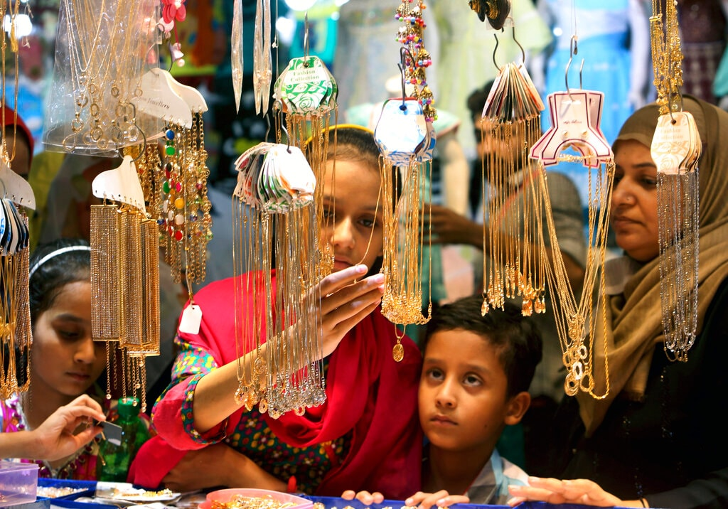 Girls buy jewelry in preparation for the upcoming Eid al-Fitr celebrations, in Karachi, Pakistan, Thursday, May 30, 2019. (AP Photo/Fareed Khan)