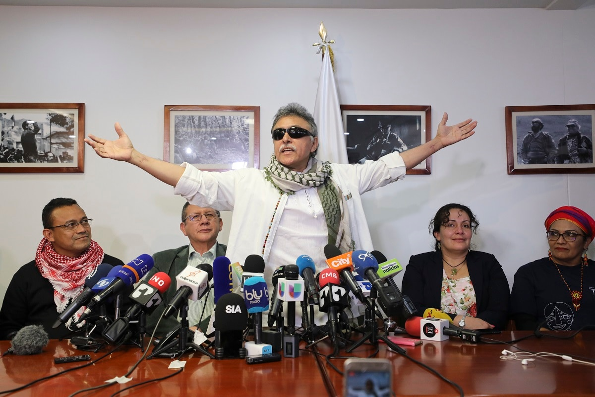 Former rebel leader Seuxis Hernandez, also known as Jesus Santrich, opens his arms during a press conference at the FARC party headquarters after he was freed from his second detention in connection with a drug case in Bogota, Colombia. Colombia's Supreme Court decided that the former FARC peace negotiator, who is accused of conspiring to ship cocaine to the US, should be released and determined that his case is part of that court's jurisdiction because of his post as a legislator. (AP Photo/Fernando Vergara)