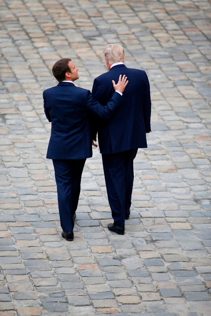 French President Emmanuel Macron and US President Donald Trump, right, walk in the courtyard of the Invalides in Paris. France wants the D-Day commemoration to showcase its long friendship with the US. July 13, 2017. (AP Photo /Matthieu Alexandre, File)