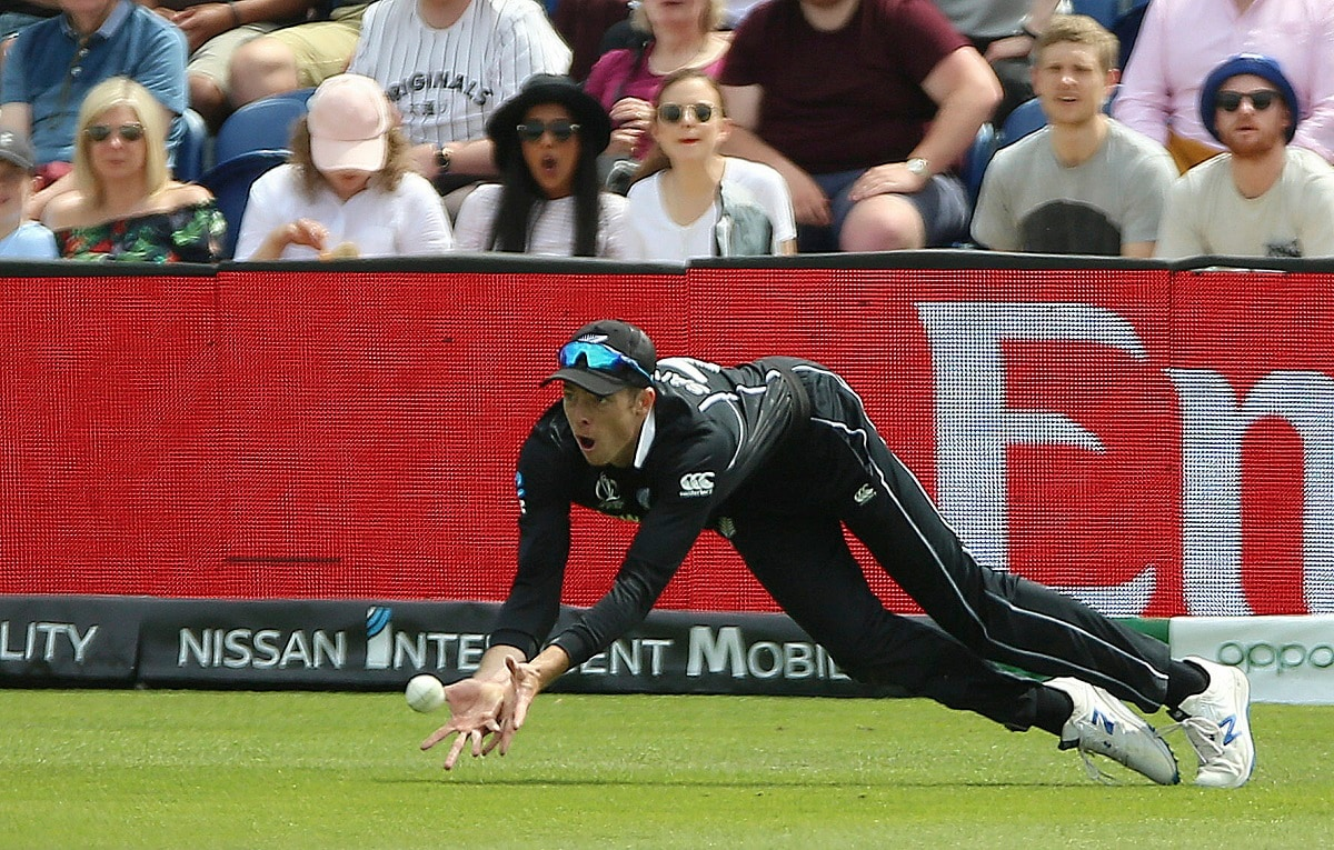 New Zealand's Mitchell Santner claims a catch on the boundary against Sri Lanka but is not given out under review during the ICC Cricket World Cup group stage match in Cardiff. (Nigel French/PA via AP)