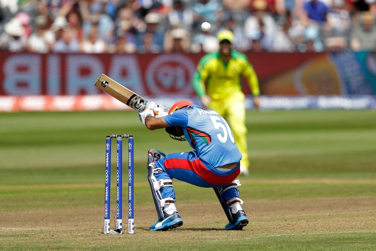 Afghanistan's Hashmatullah Shahidi ducks a bouncer off the bowling of Australia's Mitchell Starc during the Cricket World Cup match between Afghanistan and Australia. (AP Photo/Matt Dunham)
